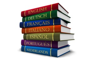Stack of books in different languages. Legal translation services and legal document translation